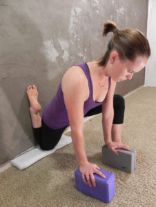 Keep the spine neutral by engaging the gluteals during this stretch.