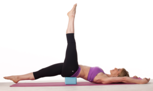 Increase the challenge of your core exercises by placing a brick underneath the pelvis.