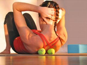 Put your back on your back with the help of some therapy balls.