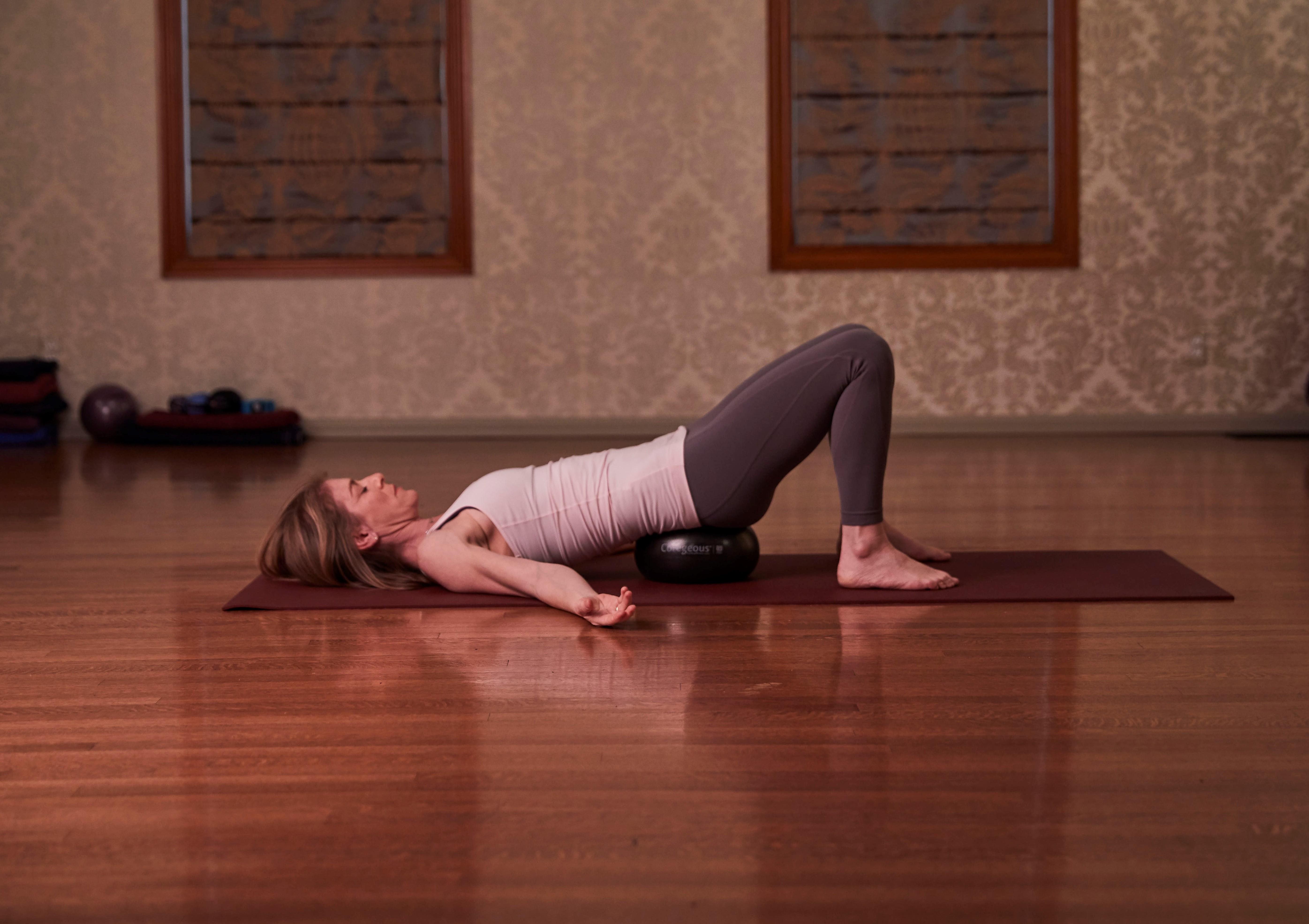 Jill Miller, female yogi, in Viapreeta Karani Mudra on Coregeous Ball